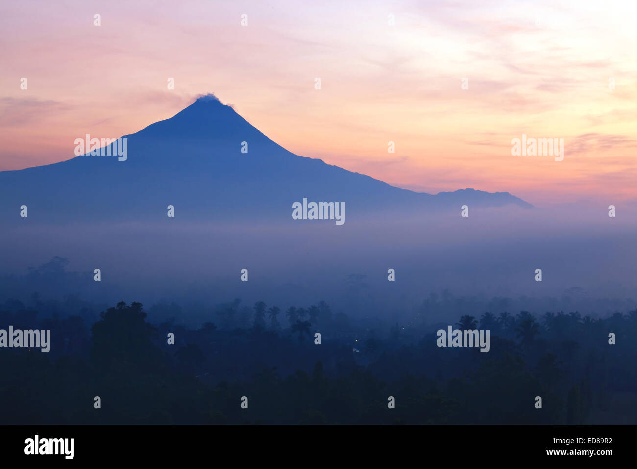 Sunrise Mountain Landscape of Mount Merapi Volcano from Borobudur Yogyakarta Indonesia - Stock Image