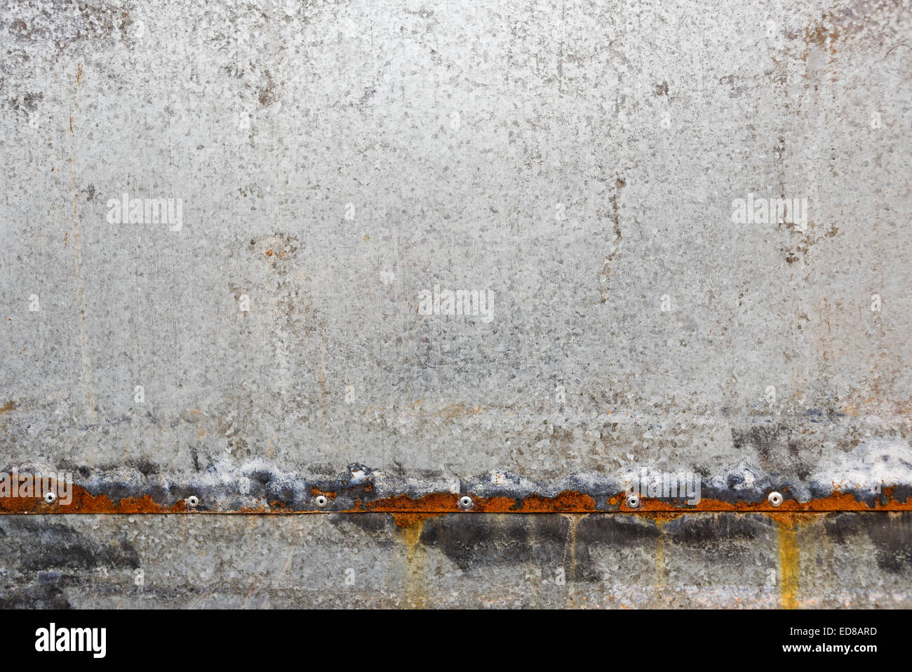 Zinc coated galvanized steel metal sheet plate pattern texture with rusty edges. - Stock Image