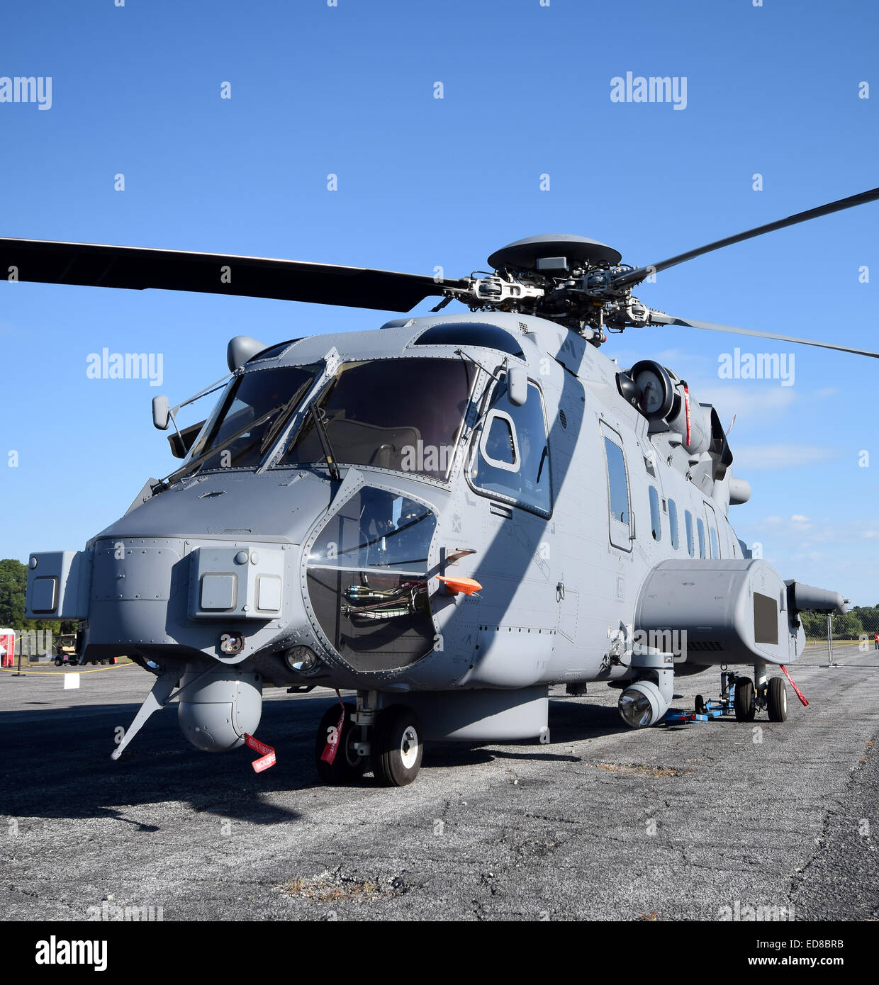 Heavy navy helicopter on the ground front view - Stock Image