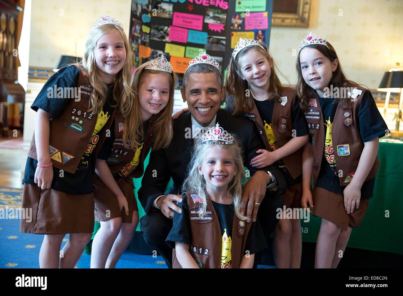 US President Barack Obama dons a princess crown as he poses for a photo with Brownies from Girl Scout Troop 2612 - Stock Image