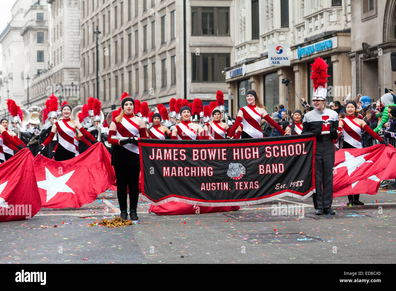 Performers from the James Bowie High School Marching Band from Austin, Texas march down Piccadilly during the London - Stock Image