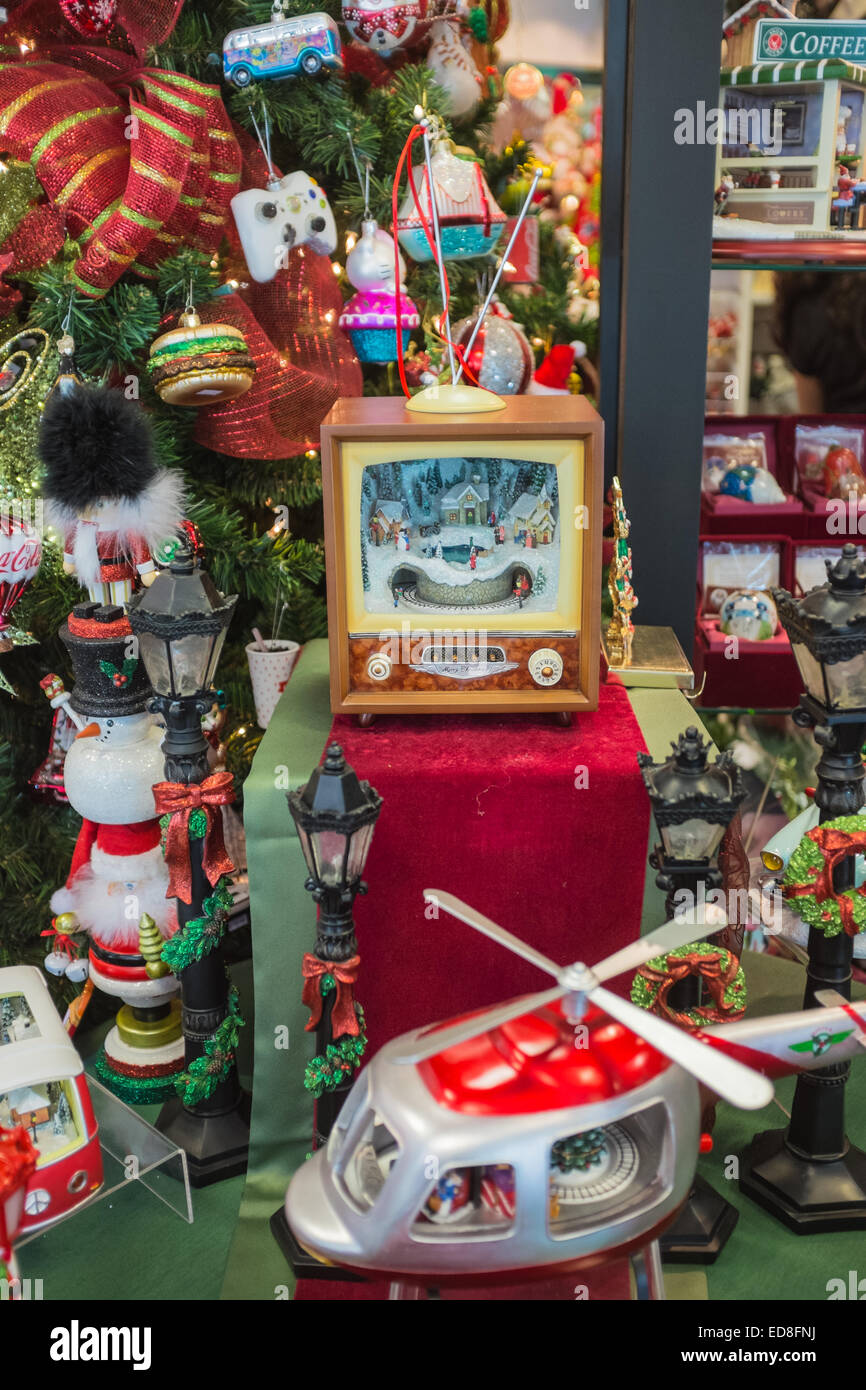 Various unnecessary gadgets for Christmas being sold in the middle of summer - Stock Image