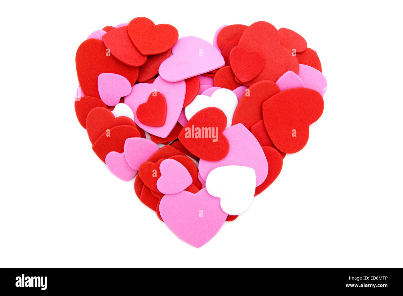 Colorful heart made of Valentines Day heart shaped confetti - Stock Image