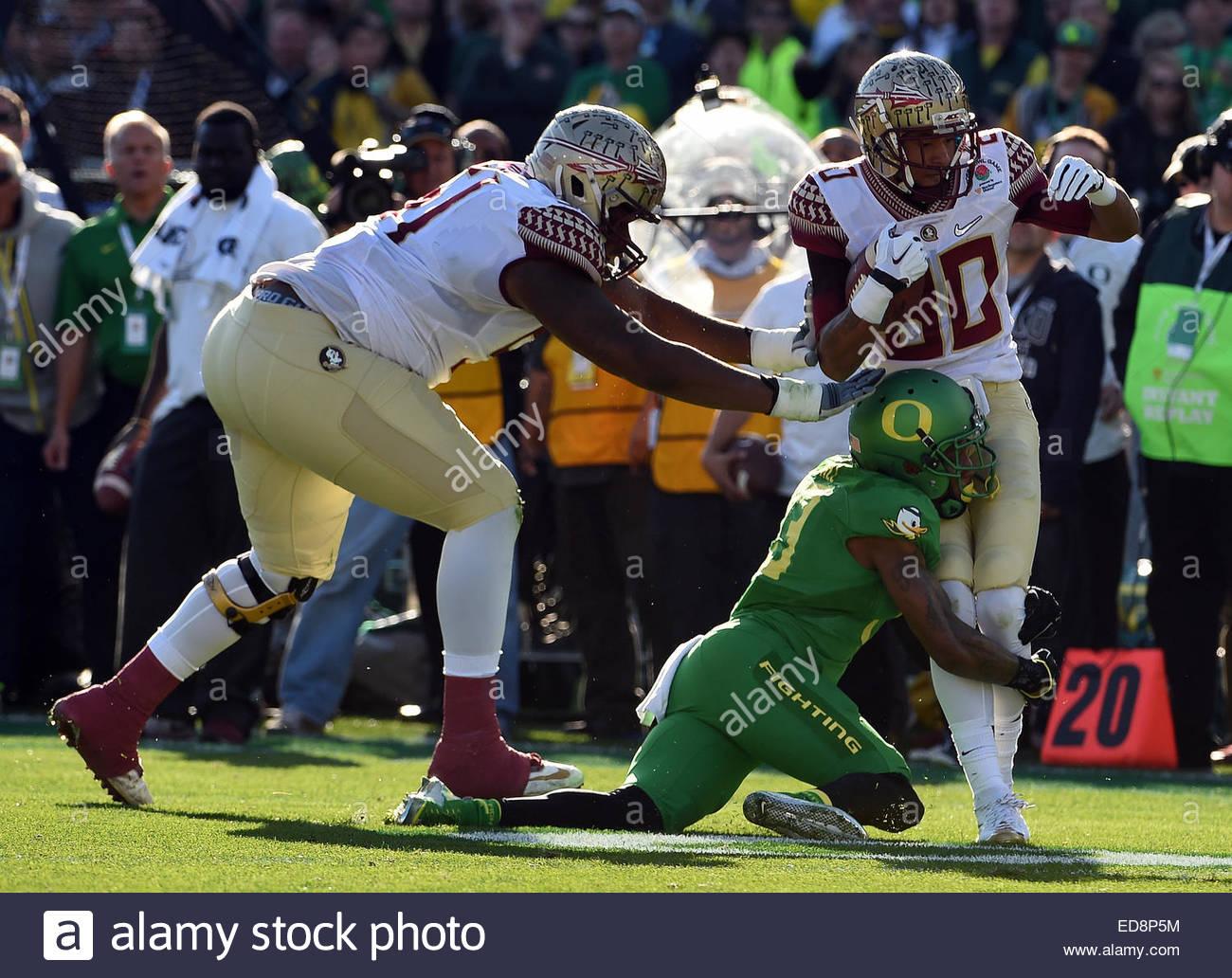 Pasadena, California, USA. 01st Jan, 2015. Oregon Ducks defensive back Troy Hill (13) tackles Florida State Seminoles - Stock Image