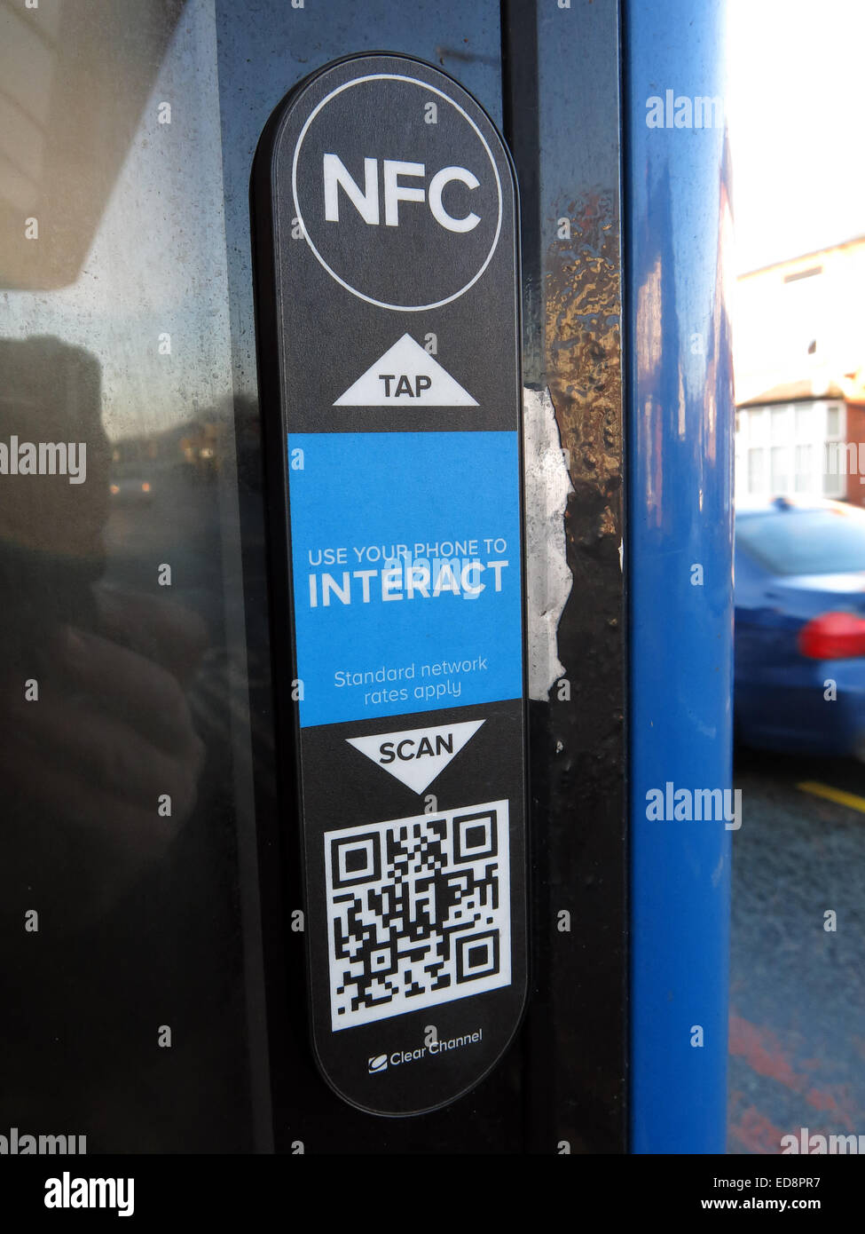 NFC Near Field Communication link on Clear Channel bus shelter ad, Grappenhall, Warrington, Cheshire, England, UK - Stock Image