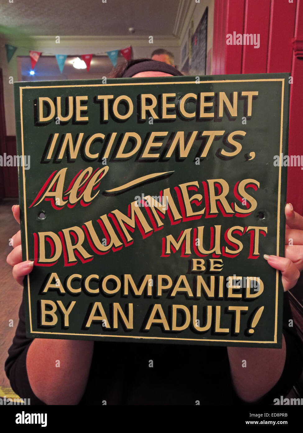 Sign Due To recent Incidents All Drummers Must be Accompanied by an adult! - Stock Image