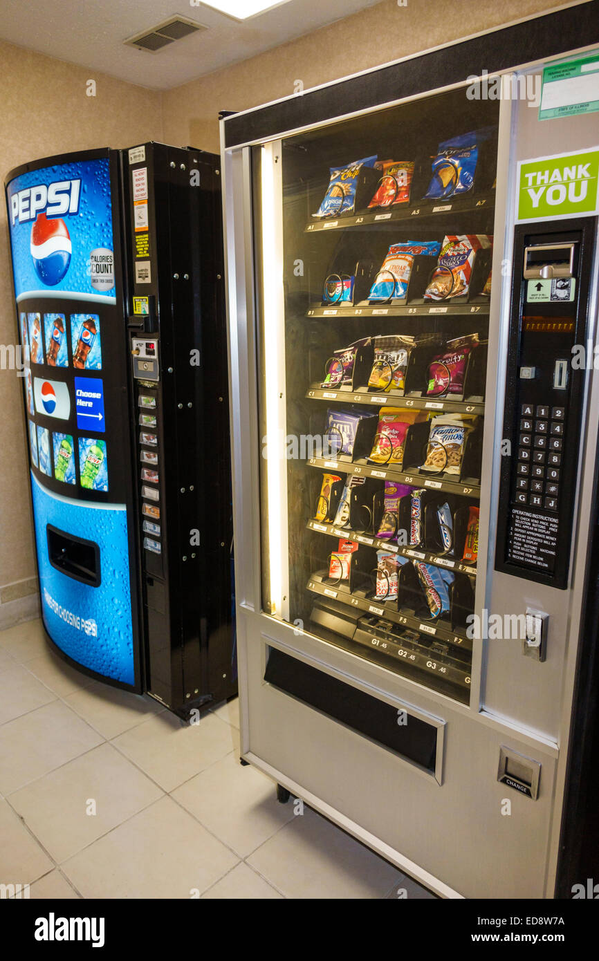 Illinois Logan County Lincoln Holiday Inn Express hotel lodging chain vending machine snacks sodas soft drinks Pepsi - Stock Image