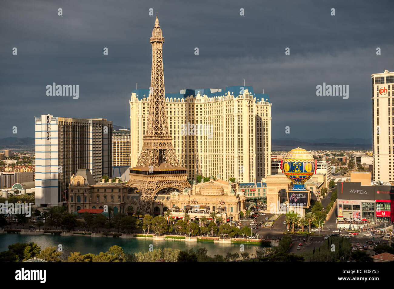 Las Vegas Boulevard by night with Paris Las Vegas and Bally's hotels and casinos as seen over the lake at Bellagio. - Stock Image