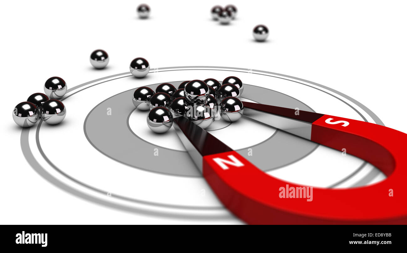 Horseshoe magnet attracting metal balls in the center of a grey target. Image concept of inbound marketing or advertising. - Stock Image