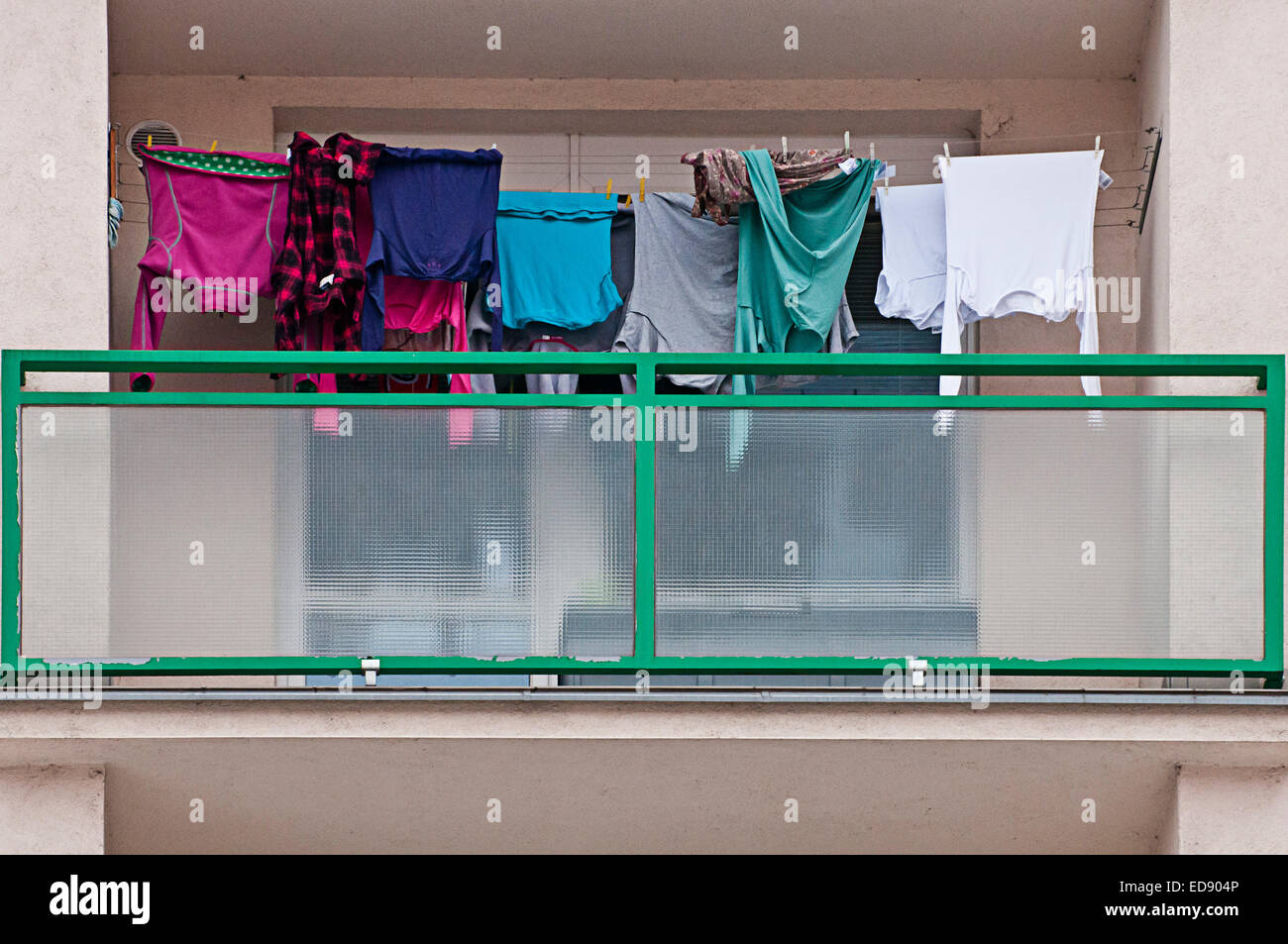 balcony of a popular apartments building, with laundry hanging to dry - Stock Image