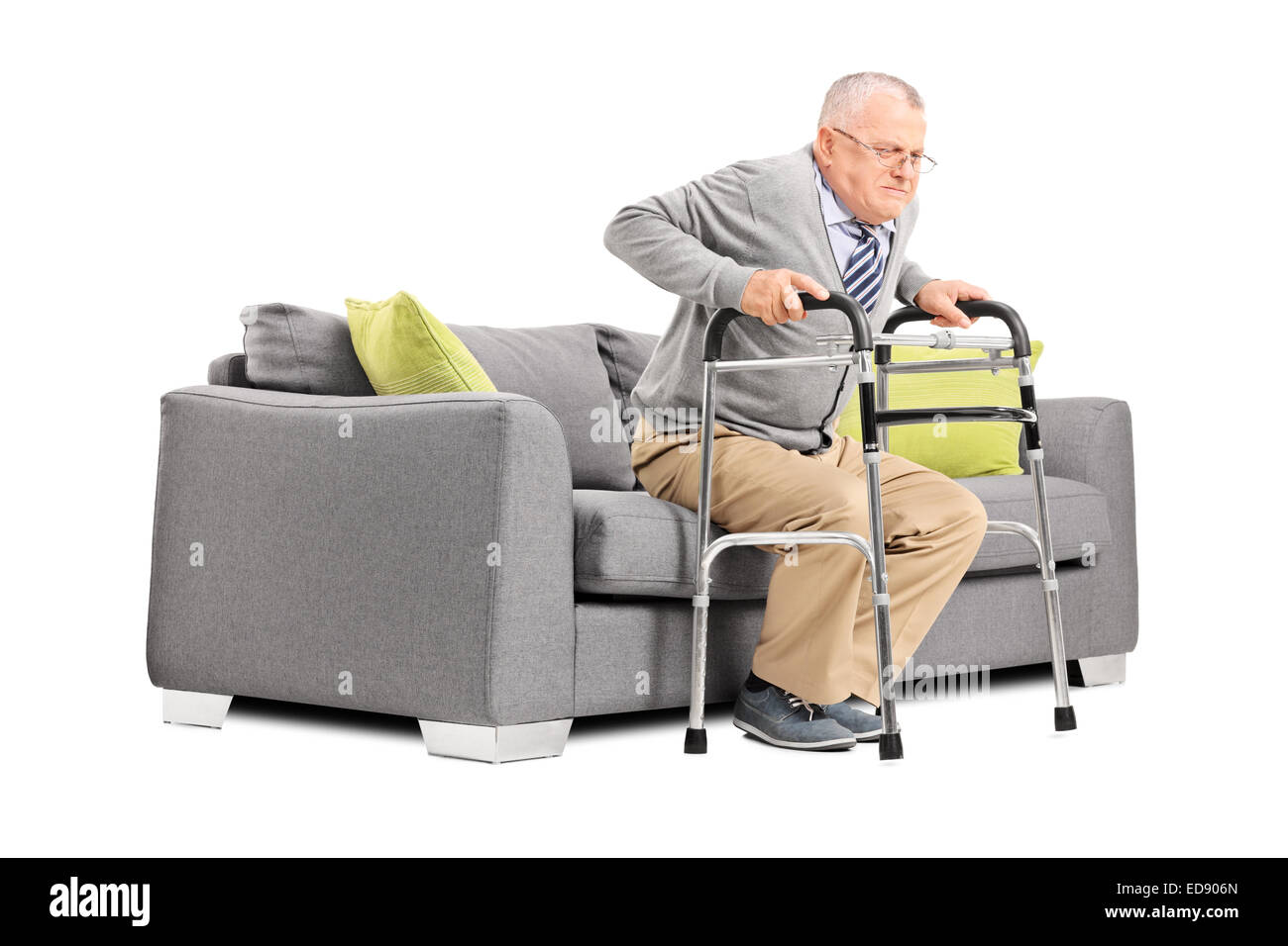 Senior trying to stand up with a walker isolated on white background - Stock Image