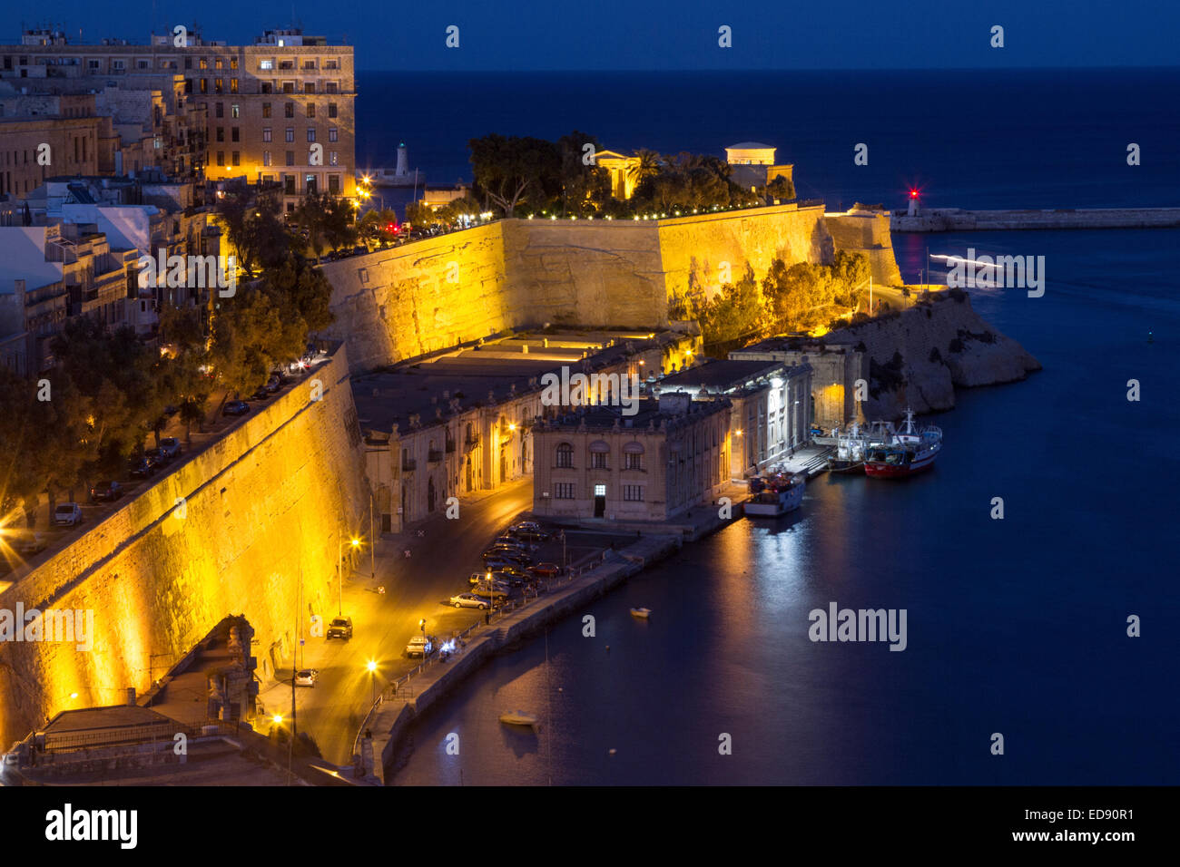 A nightime photograph of the northern side of the Grand Harbour, Valletta Malta - Stock Image