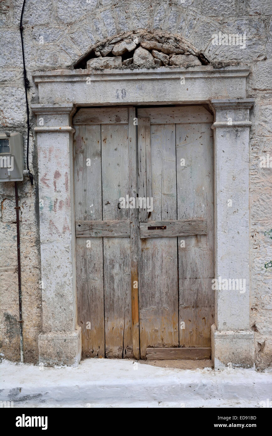 Old, unpainted wooden door in the village of Pyrgi, Chios island, Greece - Stock Image