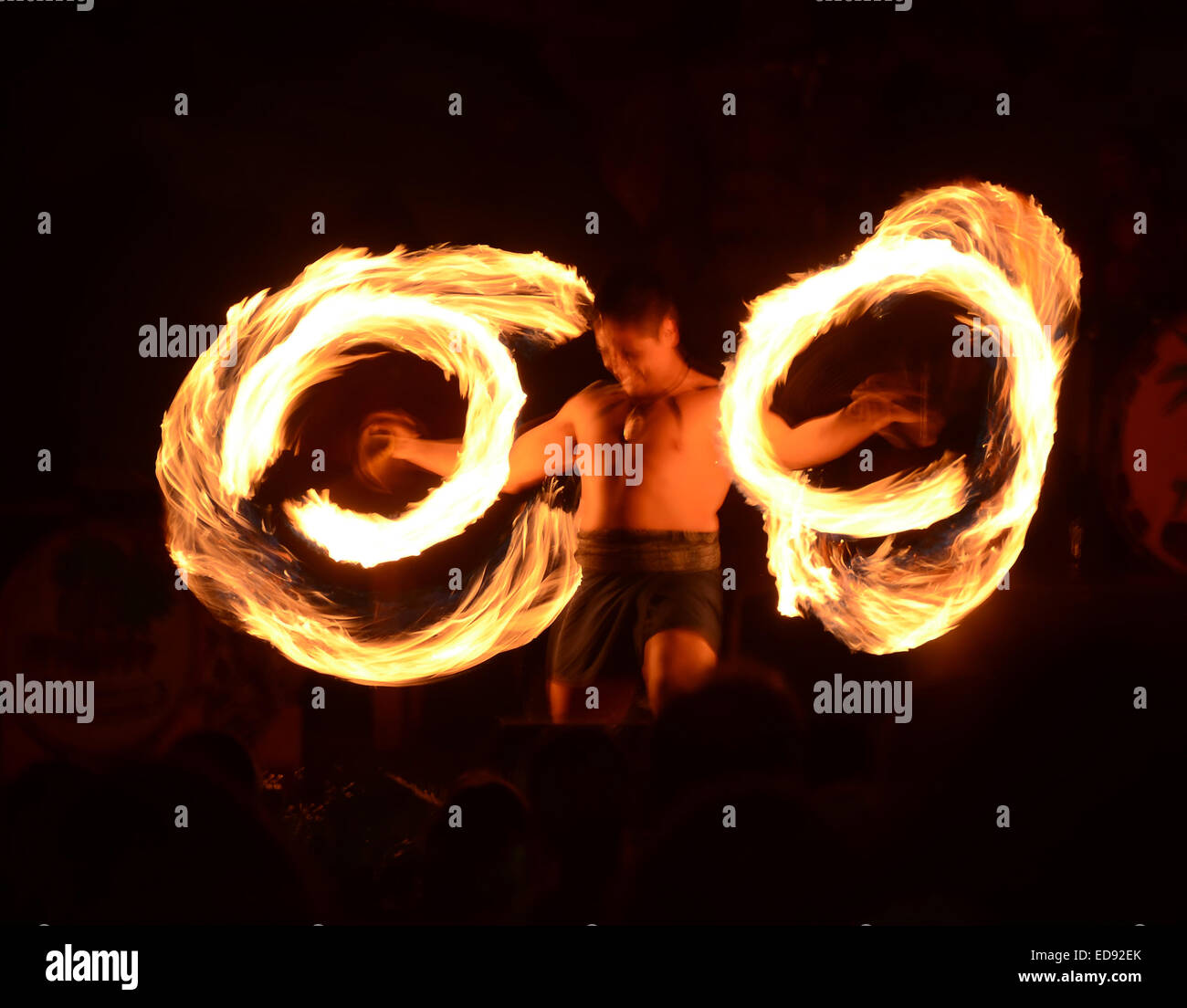 LAHAINA - MARCH 22: Polynesian dancer demonstrates fire dancing during outdoors cultural activities on March 22, - Stock Image