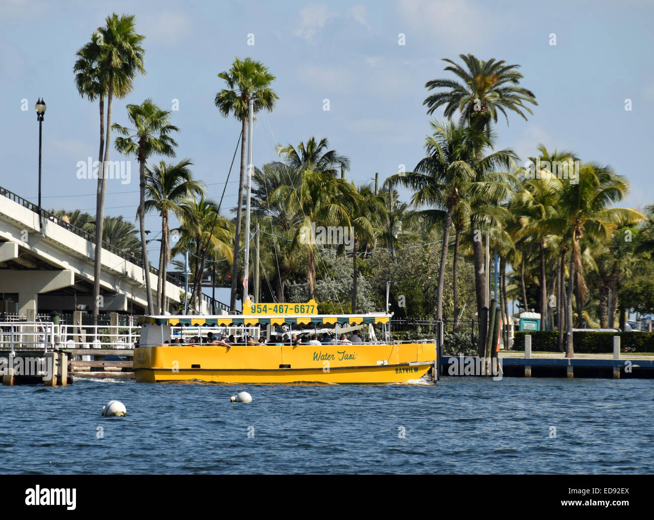 FORT LAUDERDALE - NOVEMBER 15: Tourists enjoy a trip along Fort Lauderdale's waterways aboard a water taxi on November Stock Photo