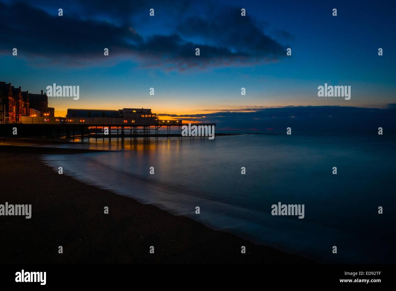 Cardigan Bay and Aberystwyth pier at dusk, long exposure image, Wales UK - Stock Image