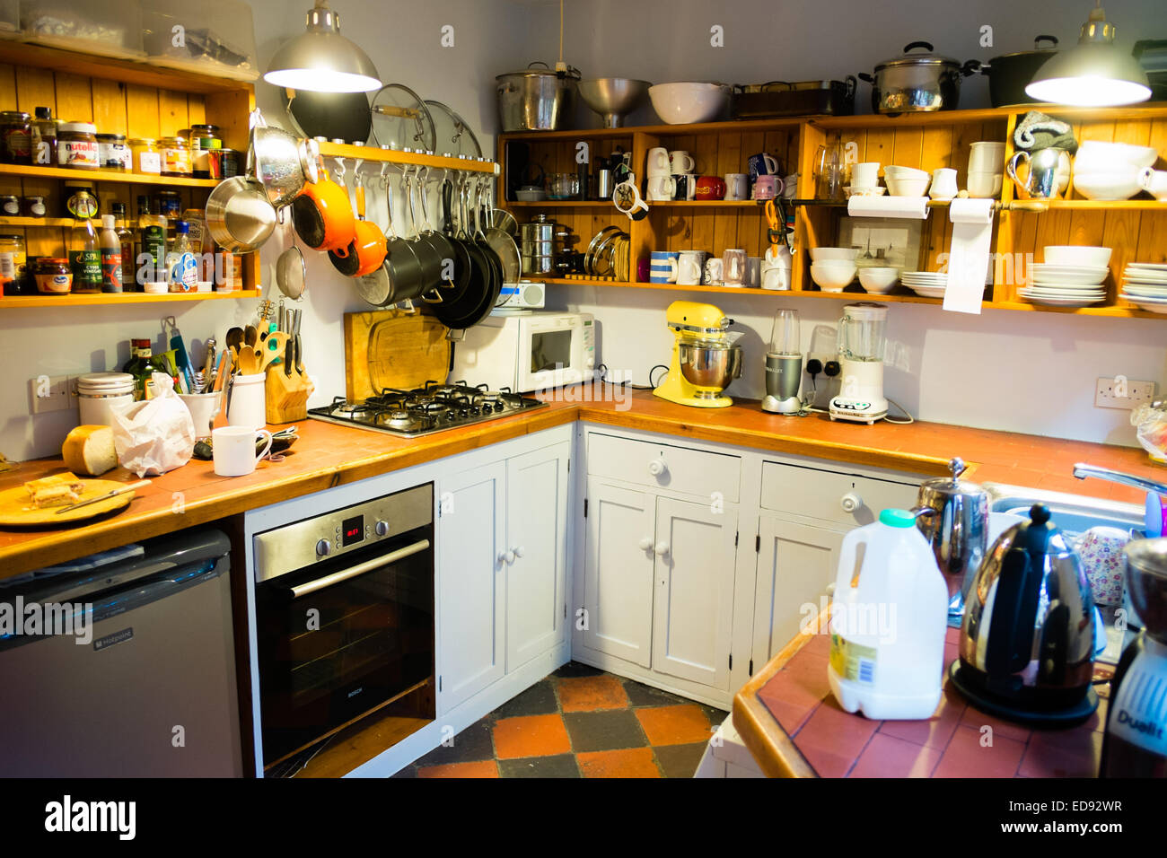 a small domestic kitchen in a terraced house uk stock photo