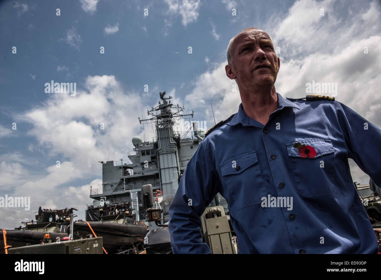 An officer stands onboard the flight deck of the RFA Argus support ship. The ship arrived in late October and is - Stock Image