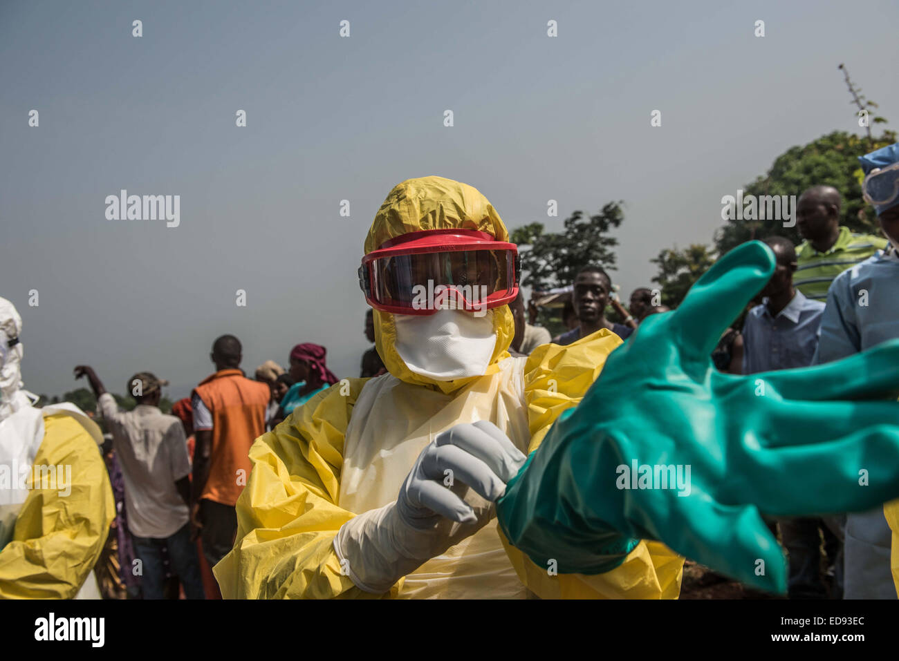 Fatmata Barrie preparing to enter the house of suspected Ebola victim in Melon st, Freetown. Unsafe burials are - Stock Image