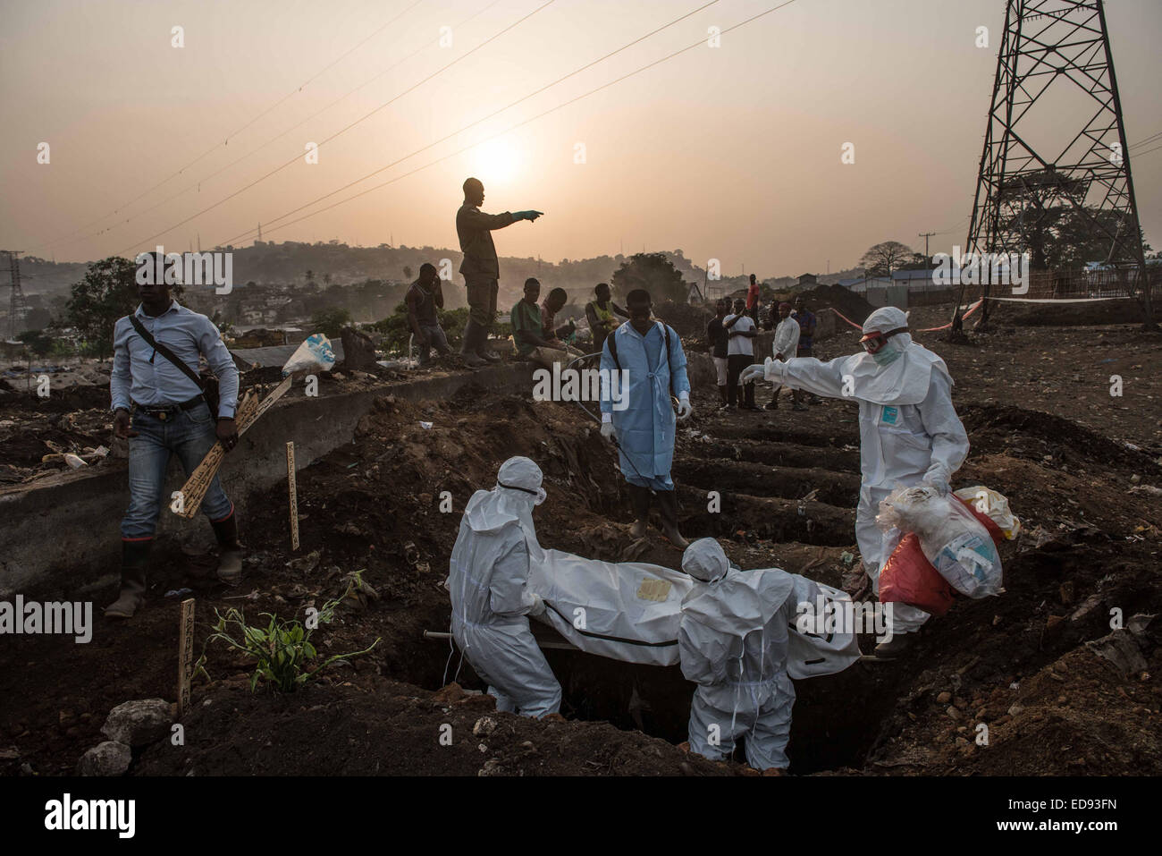 The body of Rebecca Crowther is laid in a grave at the Kingtom cemetery. Unsafe burials are one of the leading causes - Stock Image