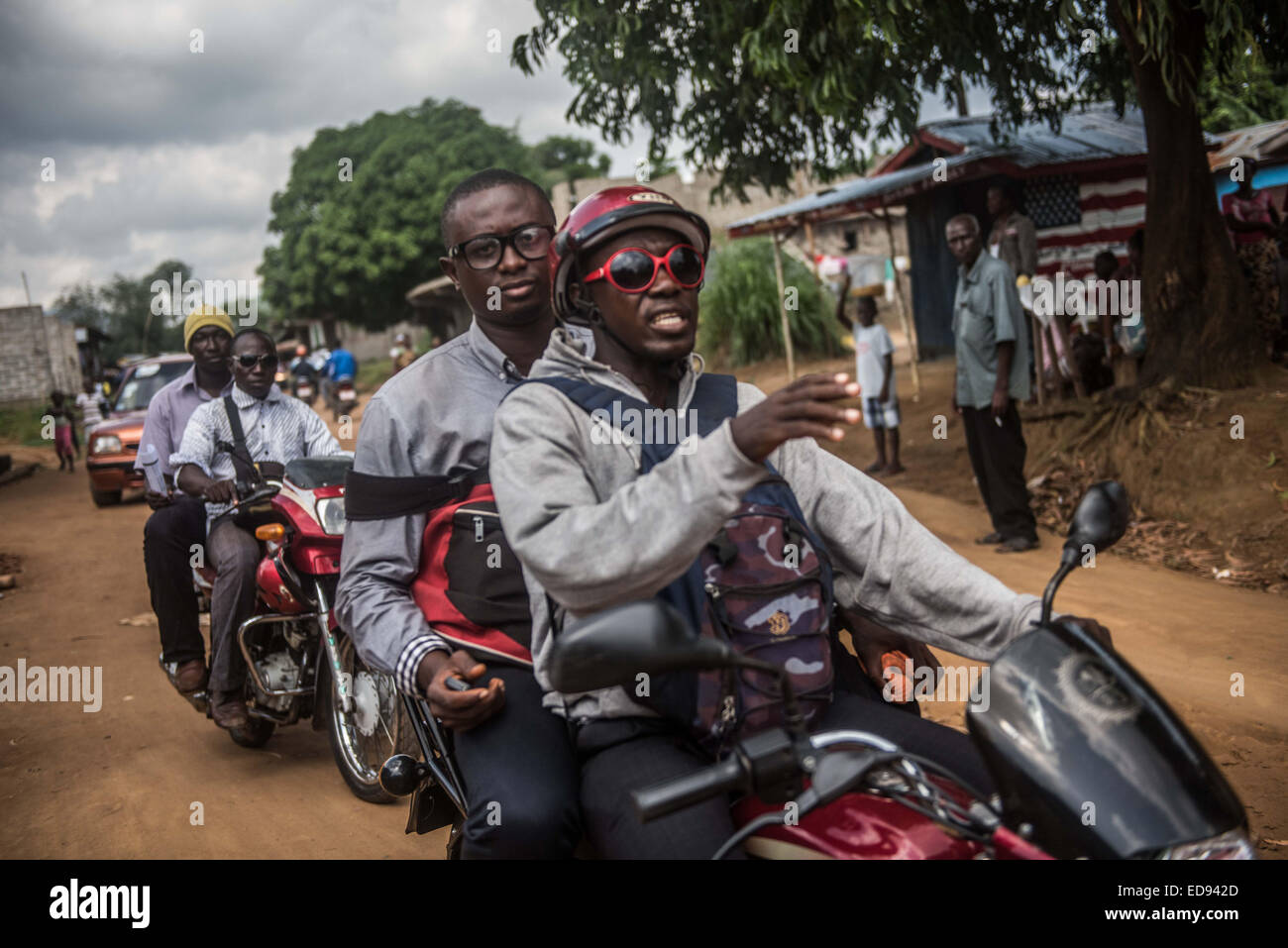Surveillance officers travel to a house affected by Ebola in Kissi Town. Tracing and isolating people who have come - Stock Image
