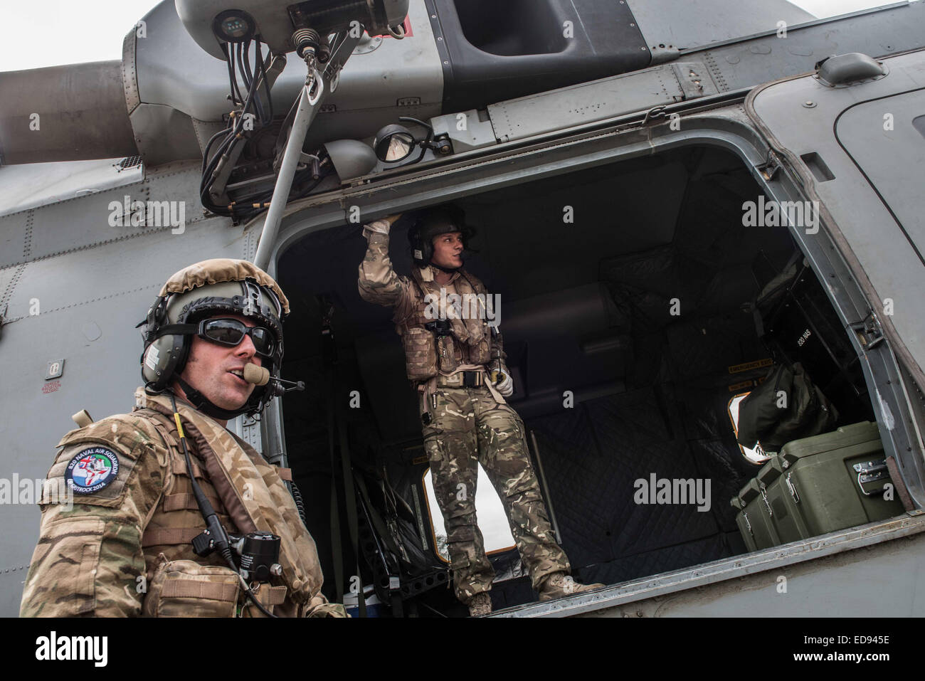 British airmen stand by a Merlin helicopter during a food drop to the Turtle Islands, which lie scattered off the - Stock Image