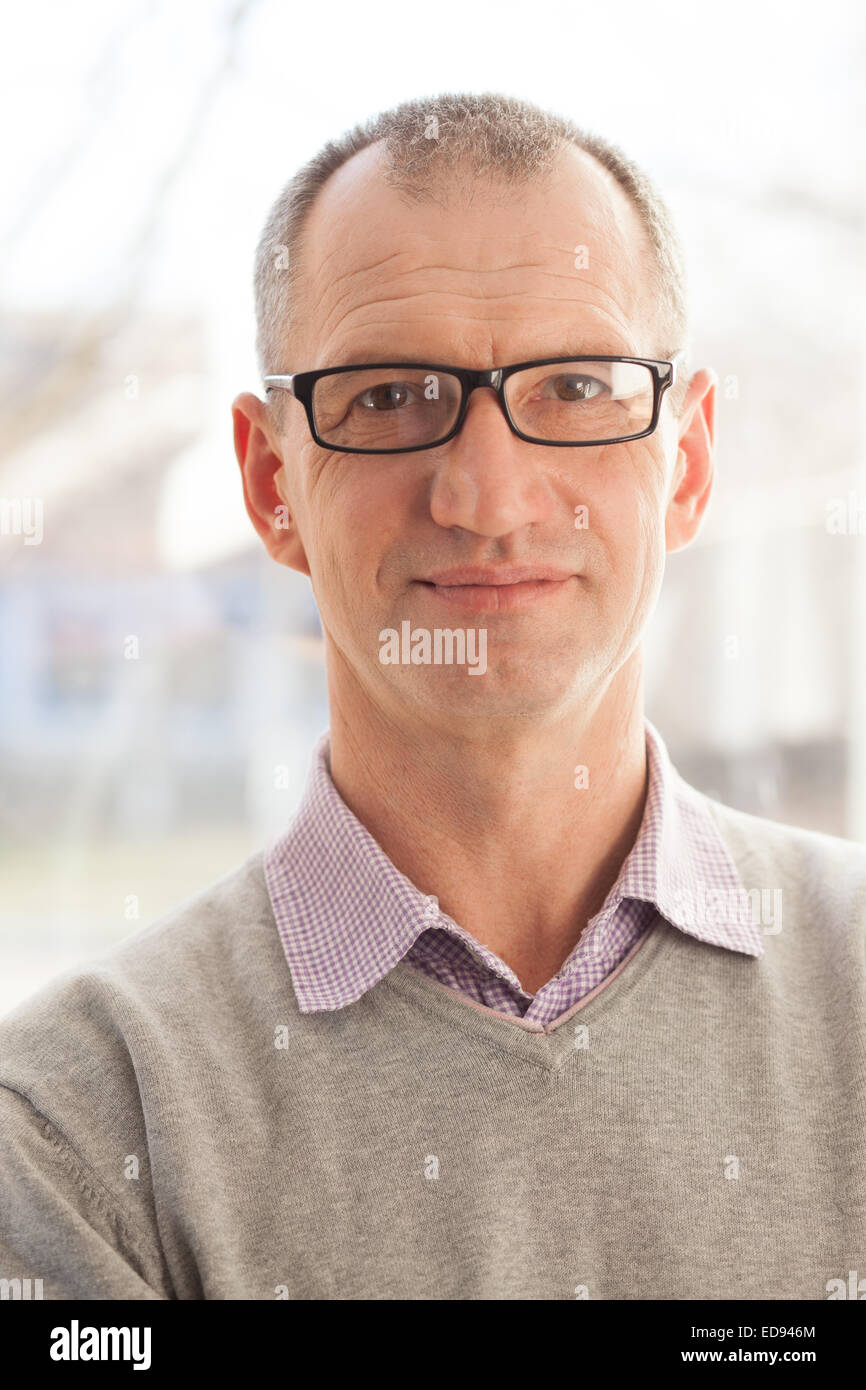 Closeup portrait of casual style adult man in glasses - Stock Image