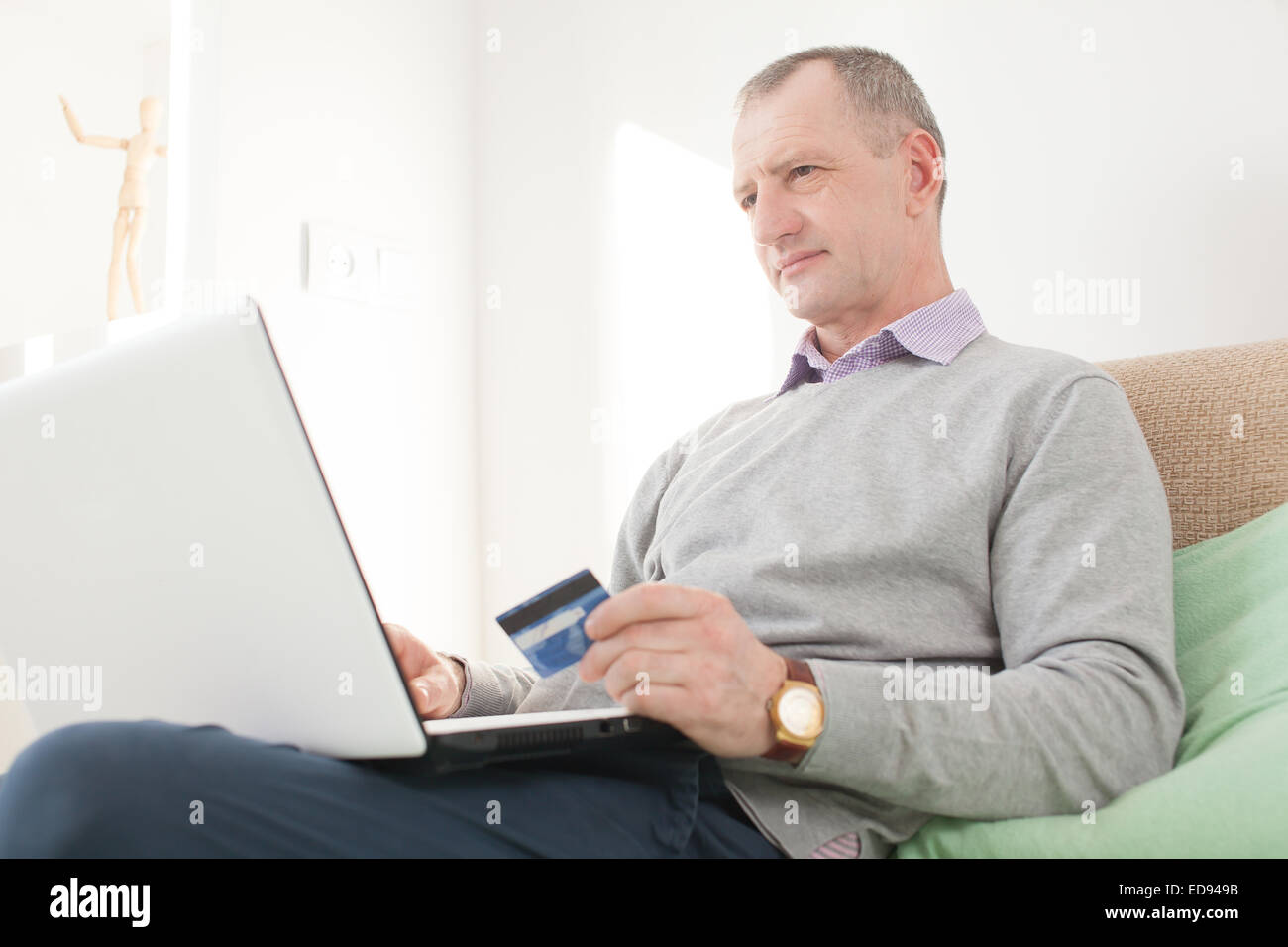 Adult man making online buying - Stock Image