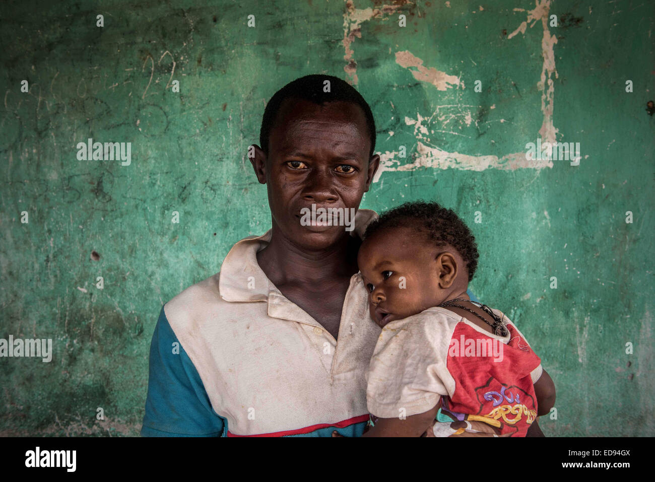 Mustapha Kamara lost his wife, and the mother of his child, Sento kamara, to Ebola. With the disease spreading through - Stock Image