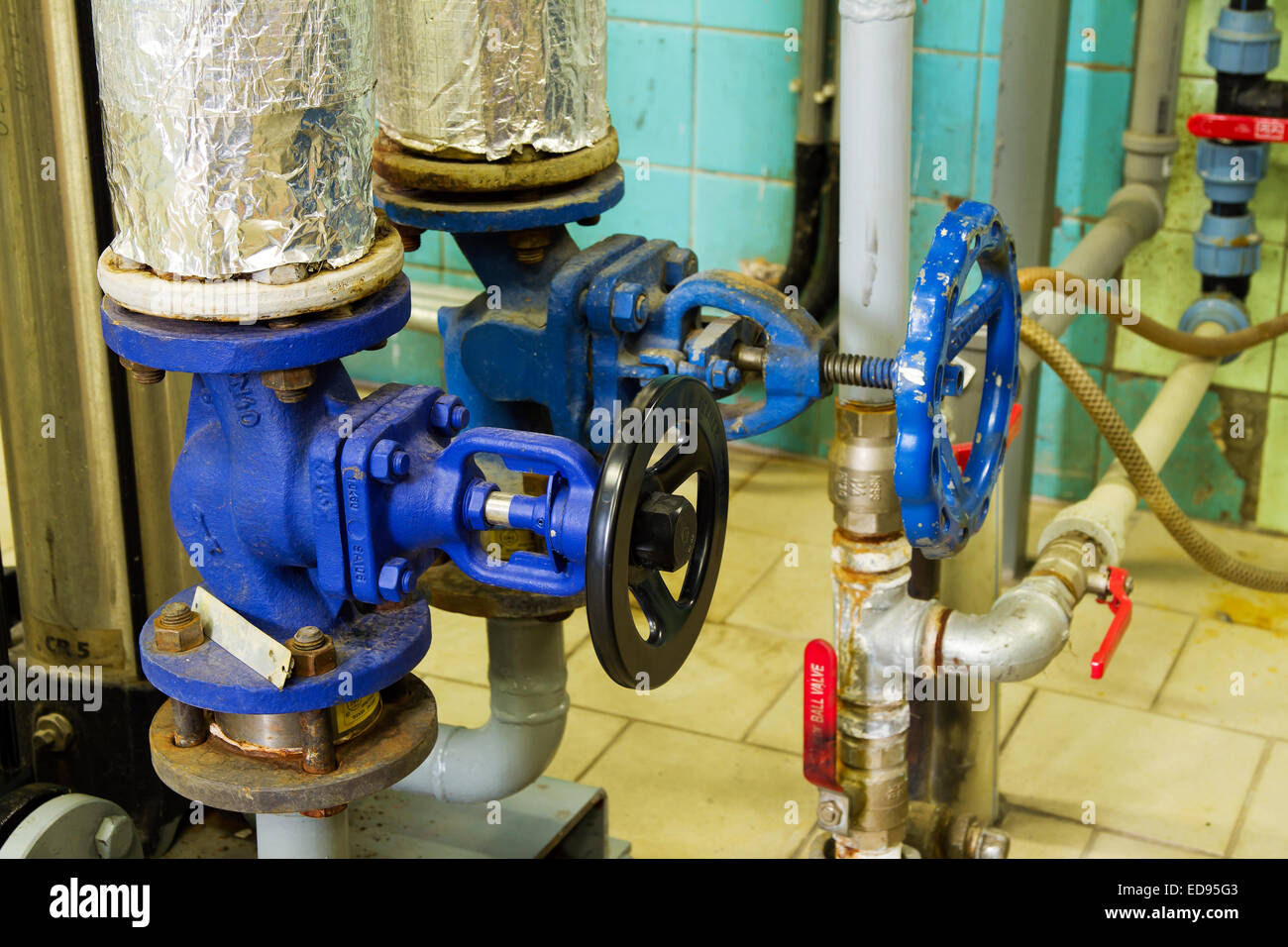 Closeup of pipes and faucet valves of heating system in a boiler ...