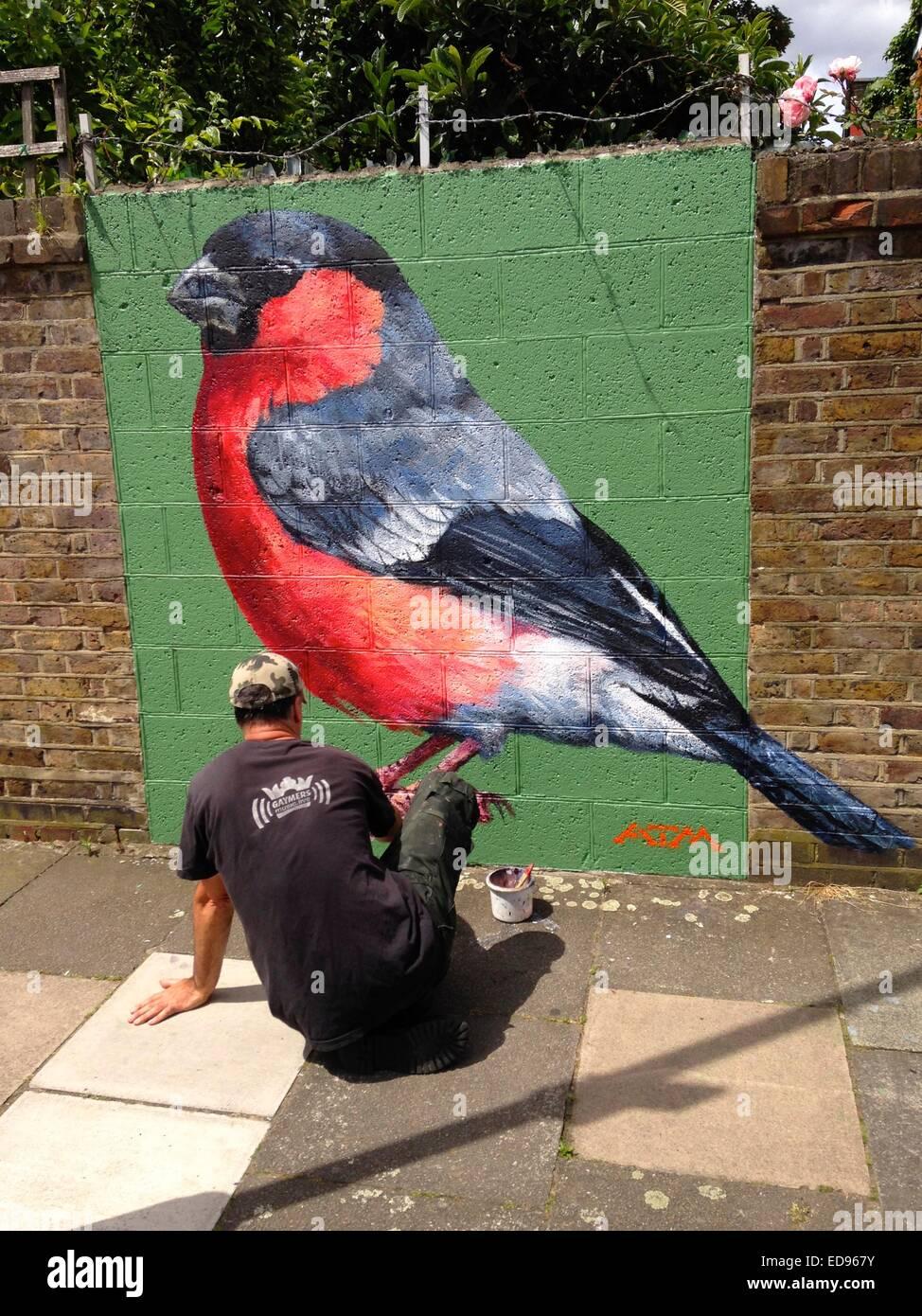 Graffiti by ATM bullfinch haringey n15 london - Stock Image