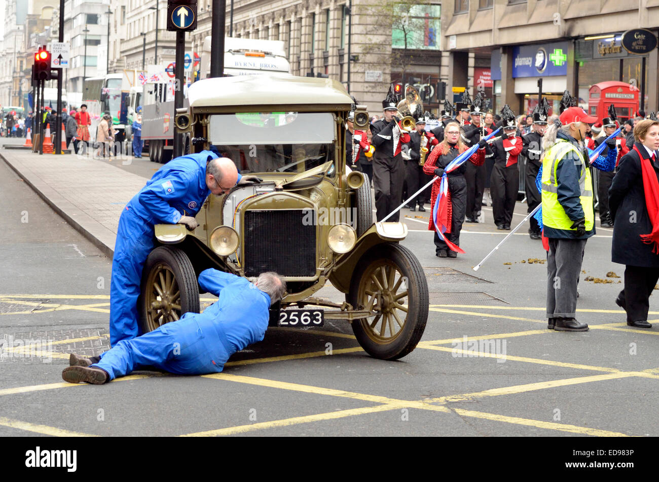 London, 1st January. New Year's day Parade from Piccadilly to Parliament Square. Trying to fix a broken down - Stock Image