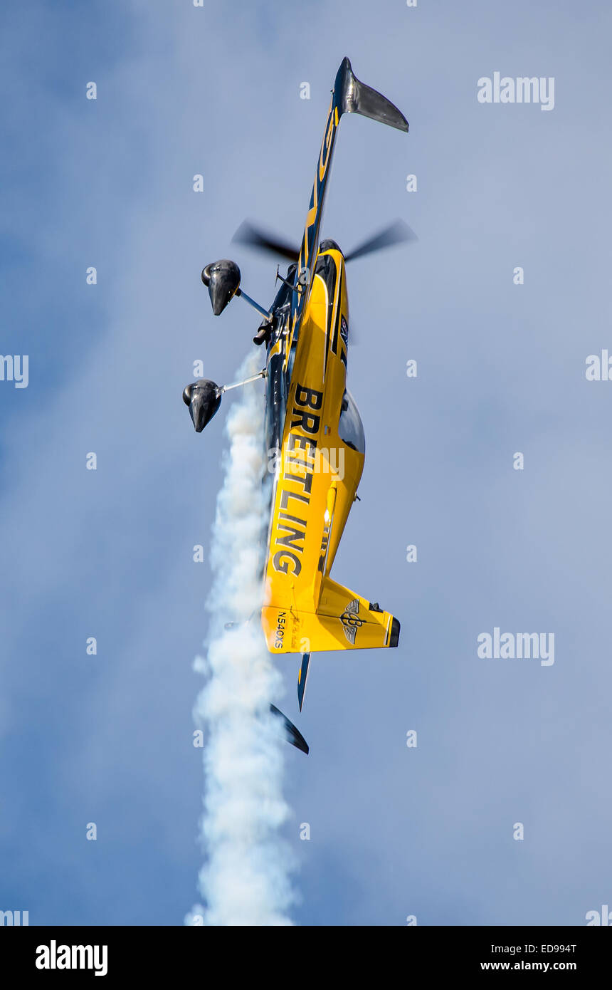 Nigel Lamb in the Breitling sponsored MXS-R aerobatic race aircraft going into a climb whilst racing at Ascot - Stock Image