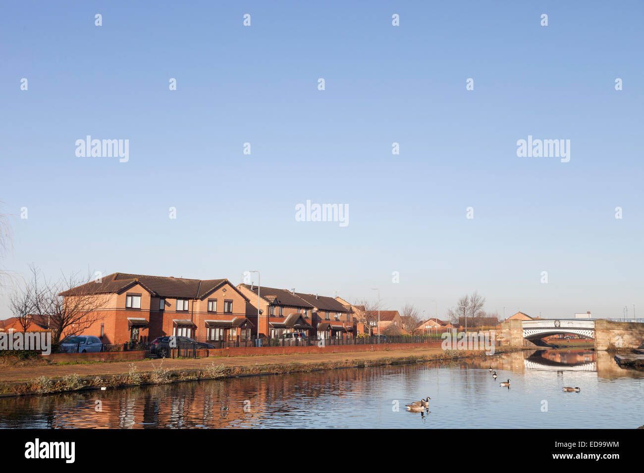 Houses stand along the Leeds and Liverpool Canal near Stanley Dock in Liverpool Stock Photo