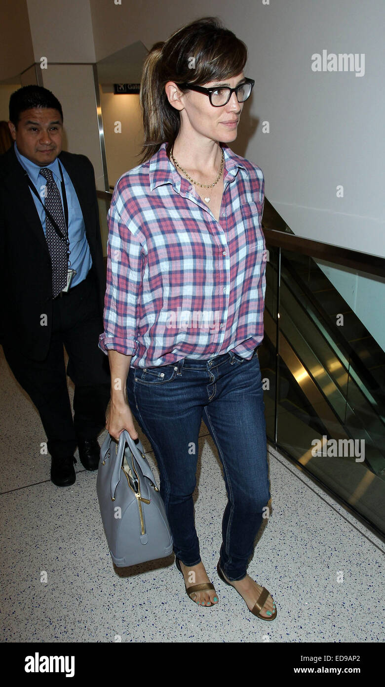 f2909e57d1 Jennifer Garner arrives at Los Angeles International Airport (LAX) wearing  a plaid button down shirt and skinny jeans Featuring  Jennifer Garner  Where  Los ...