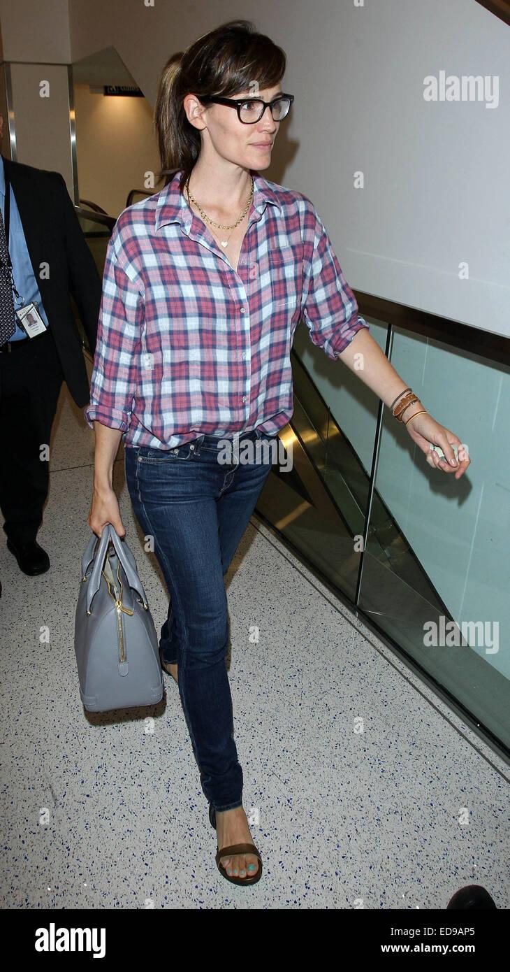 4f8b1eca5f Jennifer Garner arrives at Los Angeles International Airport (LAX) wearing  a plaid button down