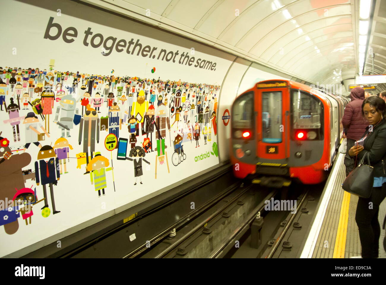 A London Underground train arrives at the platform of Oxford Circus tube station on the Victoria line, London, UK - Stock Image