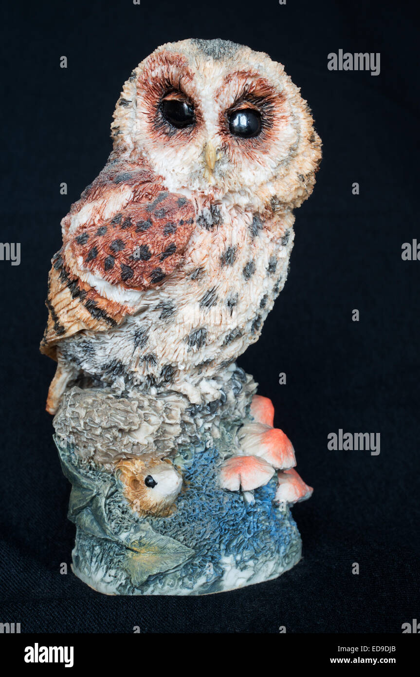 Tawny Owl figurine 015 by Arden Sculptures isolated on a black background - Stock Image