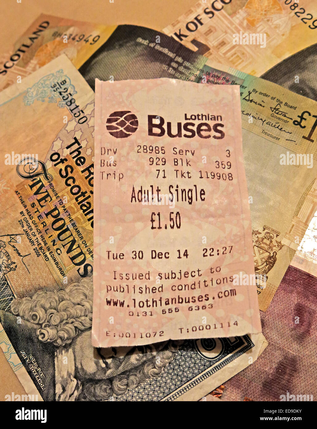 Lothian Buses bus Ticket and Scots banknotes from Edinburgh, Scotland, UK portrait format - Stock Image