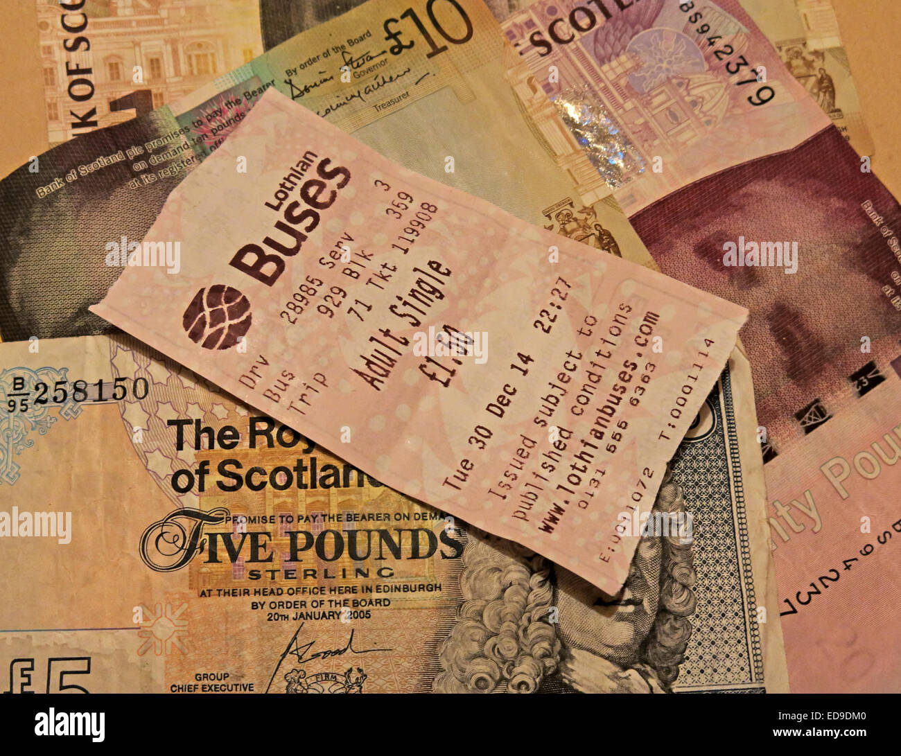 Lothian Buses bus Ticket and Scots banknotes from Edinburgh, Scotland, UK sideways - Stock Image