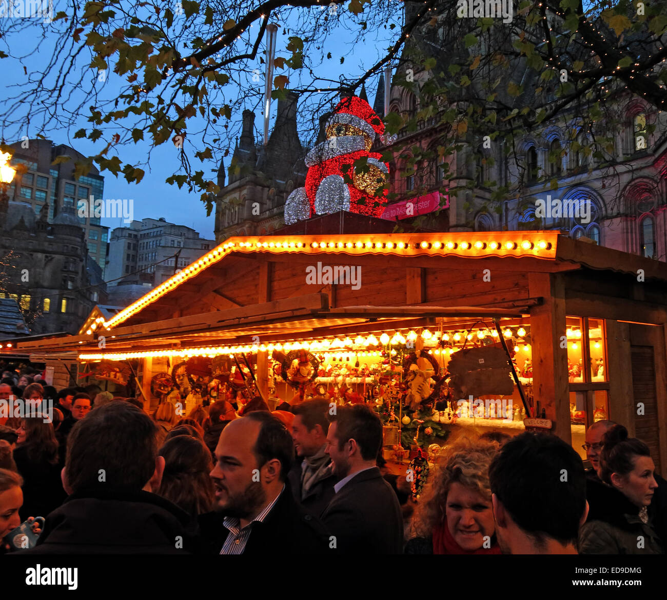 Manchester city Xmas German markets Nov/Dec, England, UK at dusk, Santa on Town Hall - Stock Image