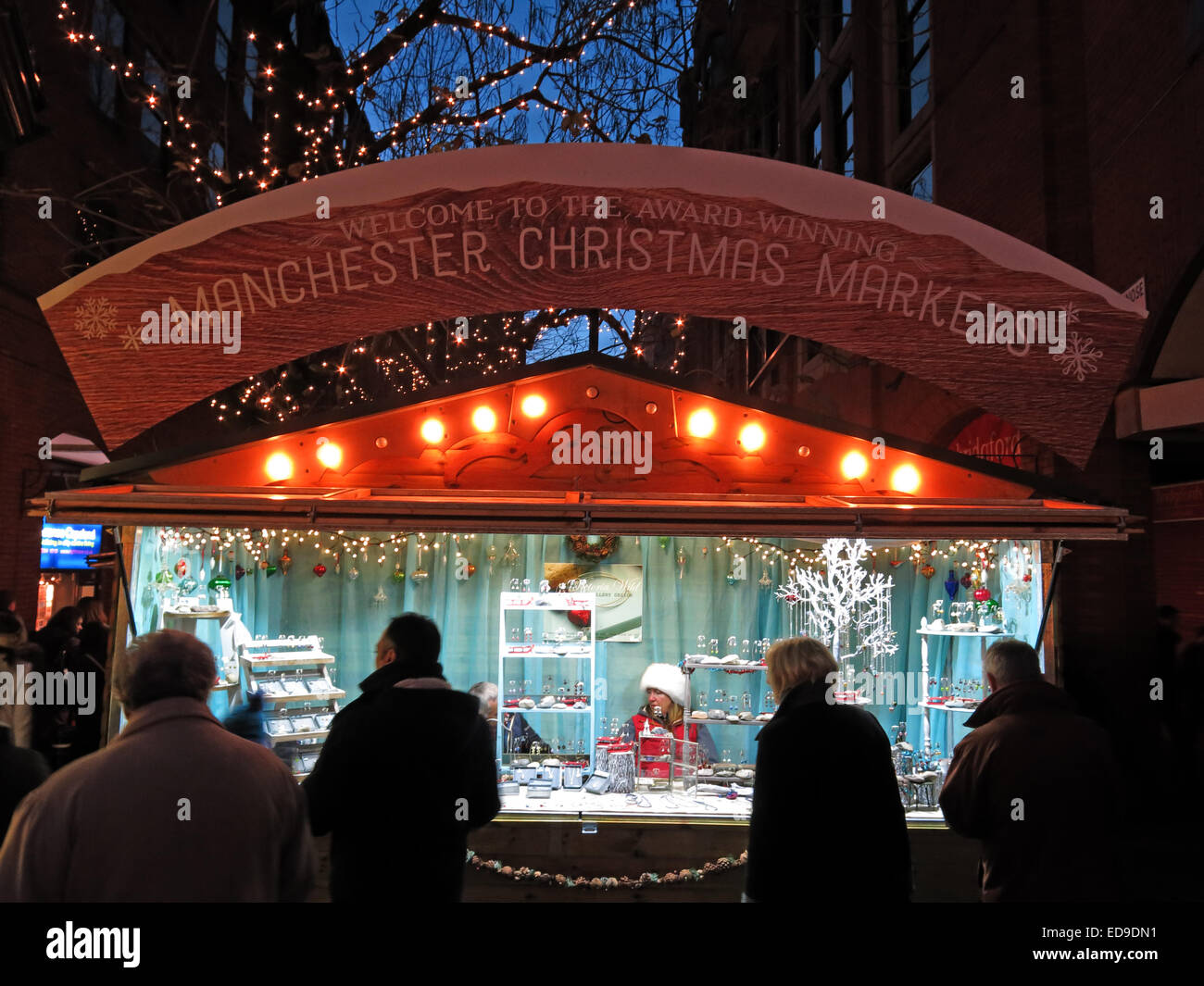 Welcome to Manchester city Xmas German markets Nov/Dec, England, UK at dusk - Stock Image