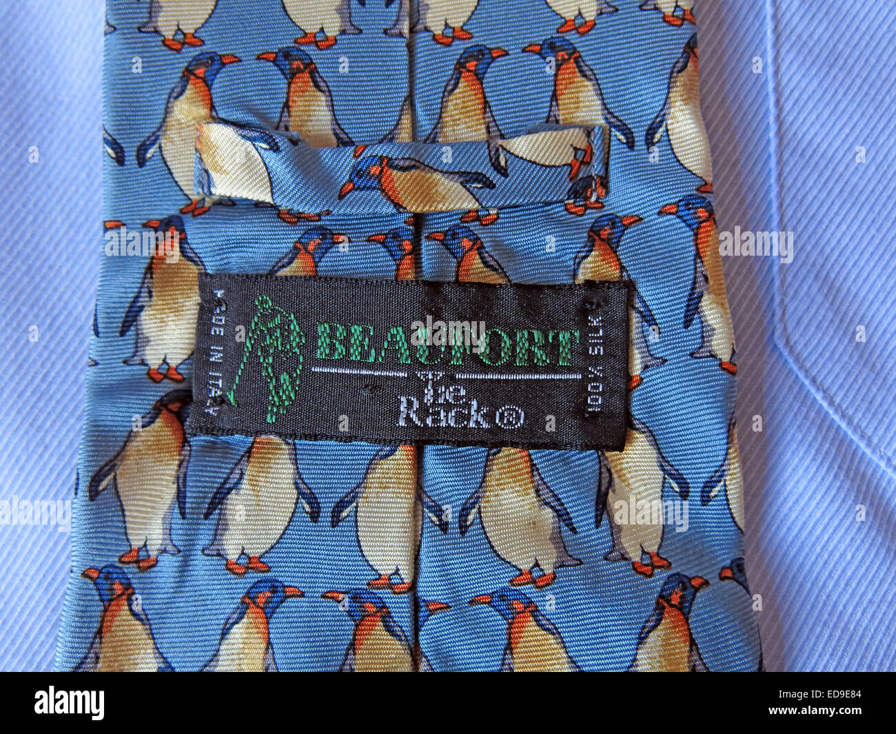 Interesting tie rack Beaufort Penguin tie, male neckware in silk - Stock Image