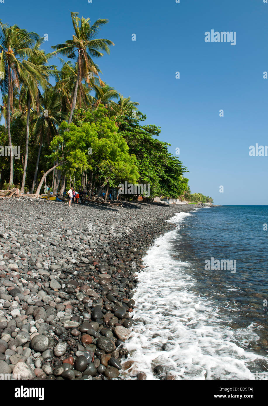 The rocky beach at Tulamben near Amed on the northeastern coast of Bali, Indonesia. - Stock Image