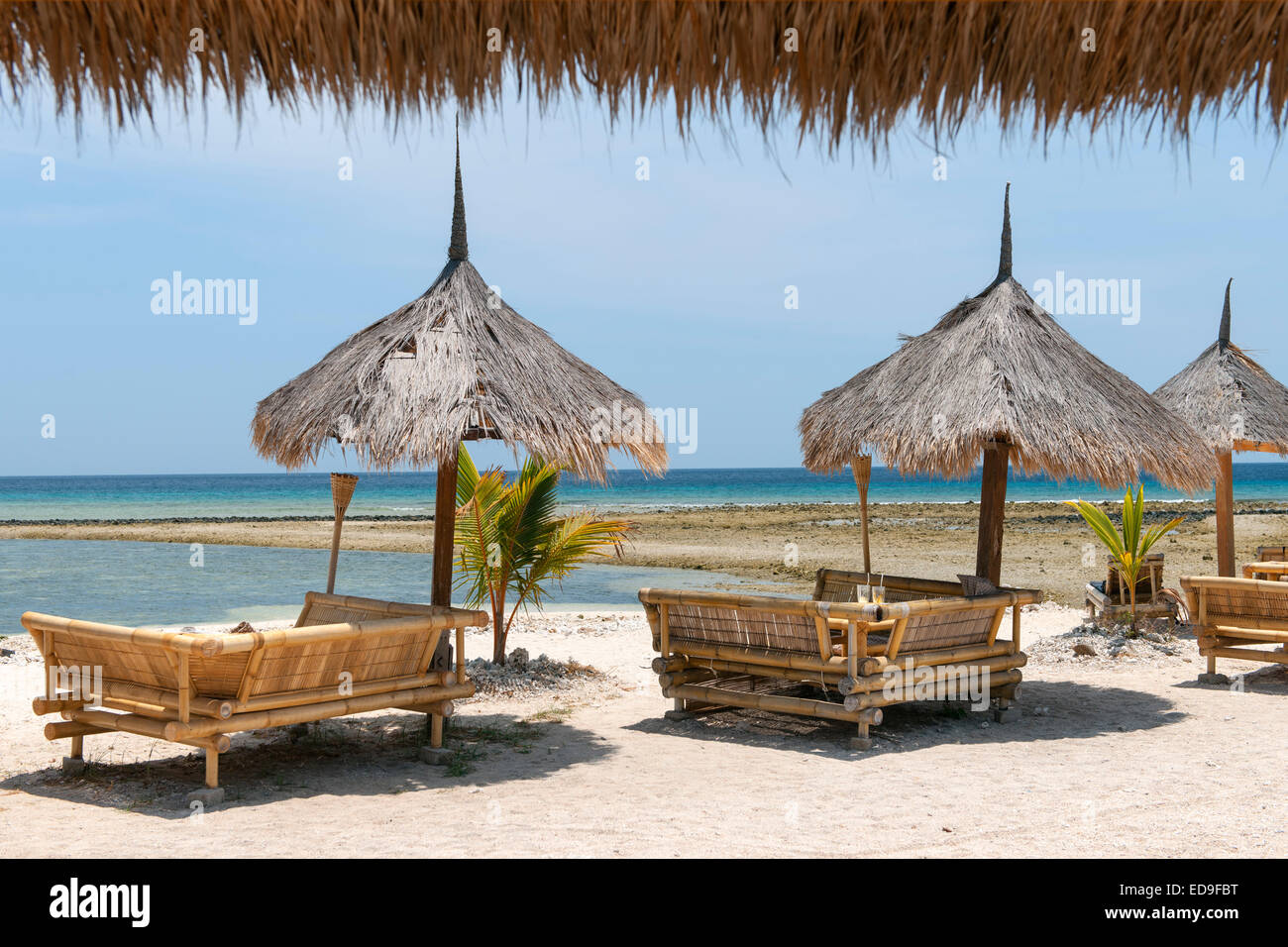 Beach loungers on Gili Air island, Indonesia. - Stock Image