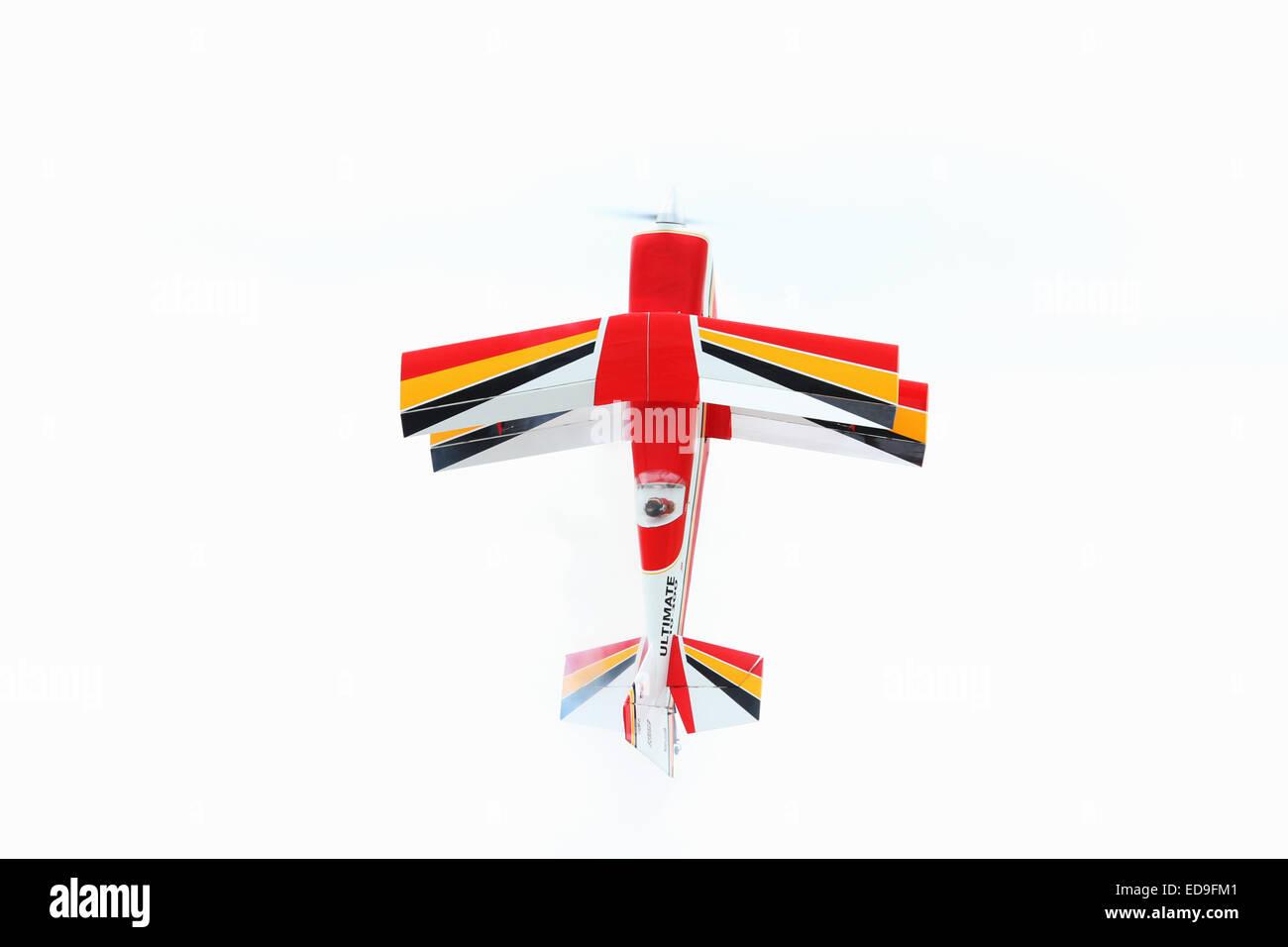 Hanging on the propeller. Ultimate 10-300 model radio control airplane. Bi Plane. Barnstorming Carnival, Springfield - Stock Image