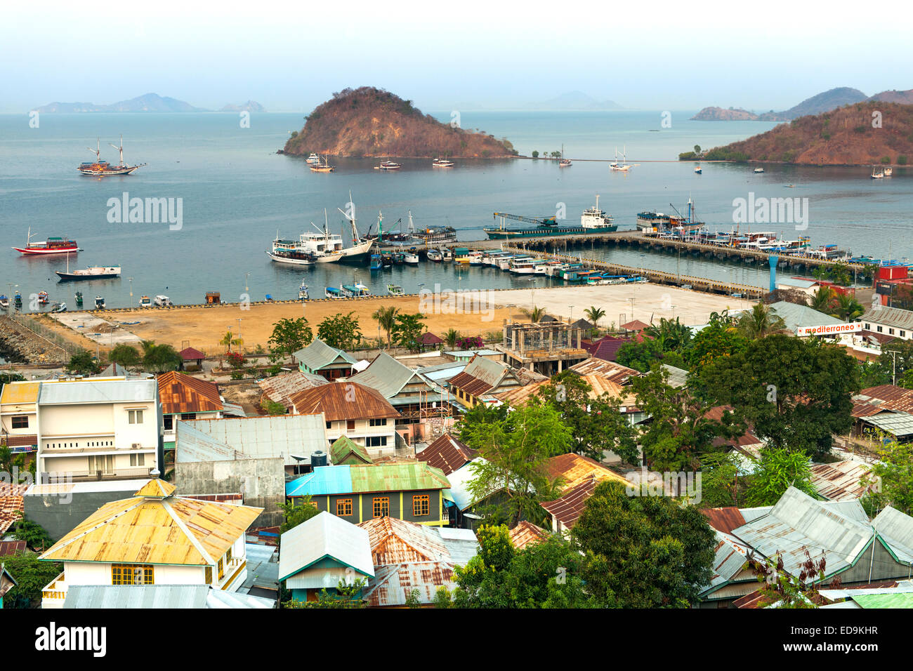 The town and port of Labuan Bajo on the island of Flores, East Nusa Tenggara, Indonesia. - Stock Image