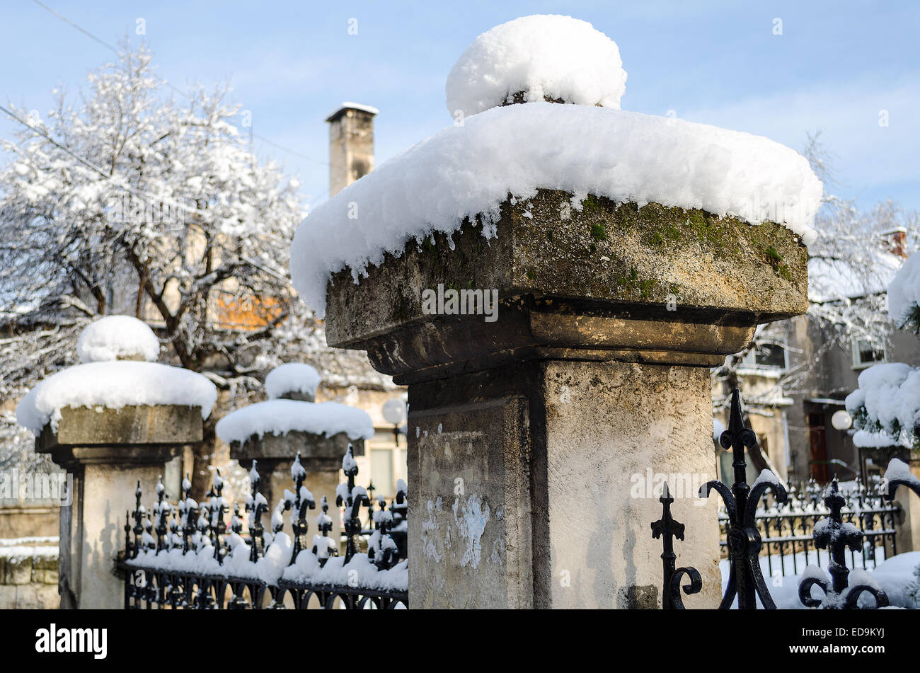 Snow cover rusty old fence closeup view Stock Photo