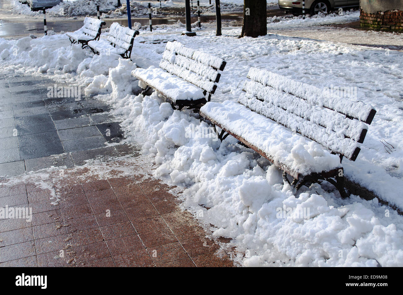 Wooden frosted bench in Russe Bulgaria closeup view Stock Photo
