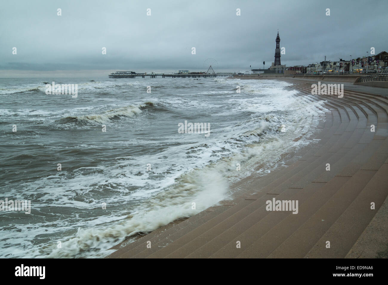 Blackpool, Lancashire, UK. 03rd Jan, 2015. A cloudy overcast start to the day in Blackpool. The sea defences are - Stock Image